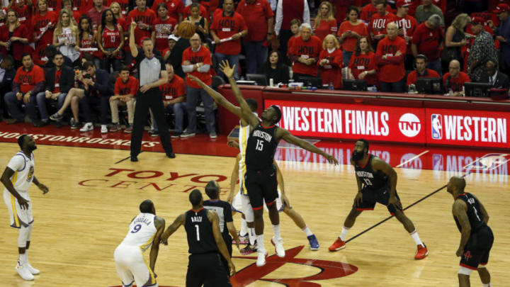 HOUSTON, TX - MAY 16: Clint Capela #15 of the Houston Rockets and Kevin Durant #35 of the Golden State Warriors compete for a jump ball to begin Game Two of the Western Conference Finals of the 2018 NBA Playoffs at Toyota Center on May 16, 2018 in Houston, Texas. NOTE TO USER: User expressly acknowledges and agrees that, by downloading and or using this photograph, User is consenting to the terms and conditions of the Getty Images License Agreement. (Photo by Tim Warner/Getty Images)