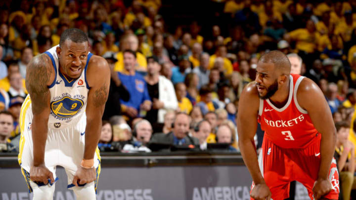OAKLAND, CA - MAY 20: Andre Iguodala #9 of the Golden State Warriors and Chris Paul #3 of the Houston Rockets talk in Game Three of the Western Conference Finals of the 2018 NBA Playoffs on May 20, 2018 at ORACLE Arena in Oakland, California. NOTE TO USER: User expressly acknowledges and agrees that, by downloading and or using this photograph, user is consenting to the terms and conditions of Getty Images License Agreement. Mandatory Copyright Notice: Copyright 2018 NBAE (Photo by Noah Graham/NBAE via Getty Images)