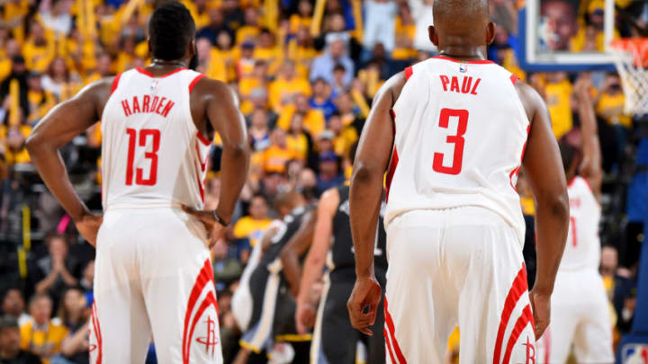 OAKLAND, CA - MAY 22: James Harden #13 and Chris Paul #3 of the Houston Rockets look on during Game Four of the Western Conference Finals during the 2018 NBA Playoffs on May 20, 2018 at ORACLE Arena in Oakland, California. NOTE TO USER: User expressly acknowledges and agrees that, by downloading and/or using this Photograph, user is consenting to the terms and conditions of the Getty Images License Agreement. Mandatory Copyright Notice: Copyright 2018 NBAE (Photo by Andrew D. Bernstein/NBAE via Getty Images)
