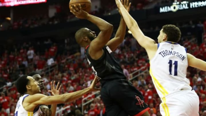 HOUSTON, TX – MAY 24: Chris Paul #3 of the Houston Rockets shoots against Klay Thompson #11 of the Golden State Warriors in the first half of Game Five of the Western Conference Finals of the 2018 NBA Playoffs at Toyota Center on May 24, 2018 in Houston, Texas. NOTE TO USER: User expressly acknowledges and agrees that, by downloading and or using this photograph, User is consenting to the terms and conditions of the Getty Images License Agreement. (Photo by Ronald Martinez/Getty Images)