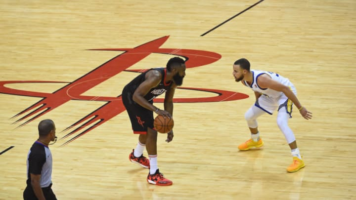 HOUSTON, TX - MAY 24: James Harden #13 of the Houston Rockets handles the ball against Stephen Curry #30 of the Golden State Warriors in Game Five of the Western Conference Finals during the 2018 NBA Playoffs on May 24, 2018 at the Toyota Center in Houston, Texas. NOTE TO USER: User expressly acknowledges and agrees that, by downloading and or using this photograph, User is consenting to the terms and conditions of the Getty Images License Agreement. Mandatory Copyright Notice: Copyright 2018 NBAE (Photo by Noah Graham/NBAE via Getty Images)