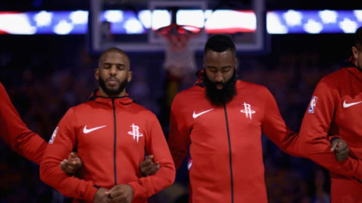 OAKLAND, CA – MAY 20: Chris Paul #3 and James Harden #13 of the Houston Rockets stand for the National Anthem before their game against the Golden State Warriors during Game Three of the Western Conference Finals at ORACLE Arena on May 20, 2018 in Oakland, California. NOTE TO USER: User expressly acknowledges and agrees that, by downloading and or using this photograph, User is consenting to the terms and conditions of the Getty Images License Agreement. (Photo by Ezra Shaw/Getty Images)