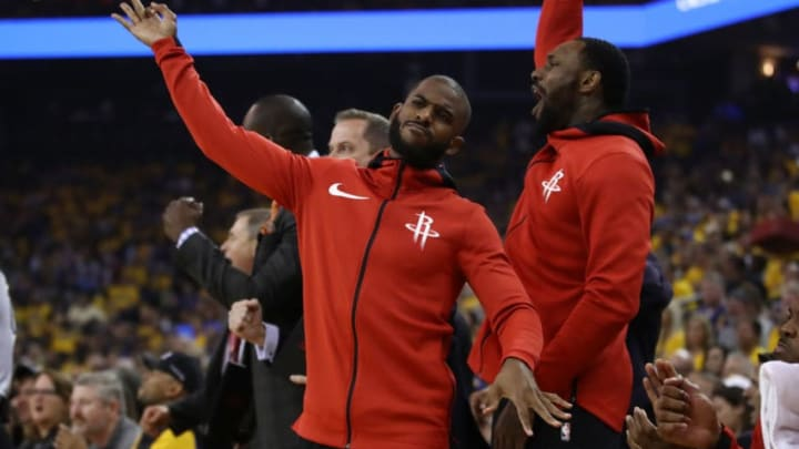 OAKLAND, CA - MAY 26: Chris Paul #3 of the Houston Rockets reacts to a three-point basket against the Golden State Warriors during Game Six of the Western Conference Finals in the 2018 NBA Playoffs at ORACLE Arena on May 26, 2018 in Oakland, California. NOTE TO USER: User expressly acknowledges and agrees that, by downloading and or using this photograph, User is consenting to the terms and conditions of the Getty Images License Agreement. (Photo by Ezra Shaw/Getty Images)