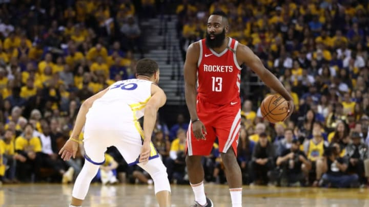 OAKLAND, CA - MAY 26: James Harden #13 of the Houston Rockets controls the ball against Stephen Curry #30 of the Golden State Warriors during Game Six of the Western Conference Finals in the 2018 NBA Playoffs at ORACLE Arena on May 26, 2018 in Oakland, California. NOTE TO USER: User expressly acknowledges and agrees that, by downloading and or using this photograph, User is consenting to the terms and conditions of the Getty Images License Agreement. (Photo by Ezra Shaw/Getty Images)