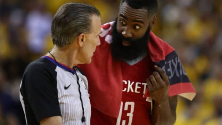 OAKLAND, CA – MAY 26: James Harden #13 of the Houston Rockets speaks with referee Ken Mauer #41 during Game Six of the Western Conference Finals in the 2018 NBA Playoffs against the Golden State Warriors at ORACLE Arena on May 26, 2018 in Oakland, California. NOTE TO USER: User expressly acknowledges and agrees that, by downloading and or using this photograph, User is consenting to the terms and conditions of the Getty Images License Agreement. (Photo by Ezra Shaw/Getty Images)