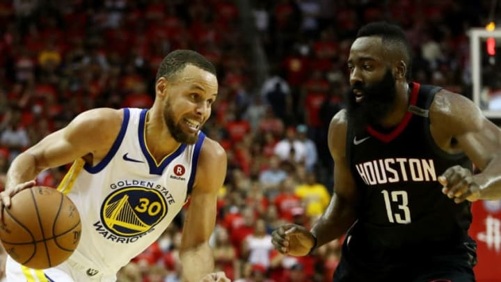 HOUSTON, TX - MAY 28: Stephen Curry #30 of the Golden State Warriors drives against James Harden #13 of the Houston Rockets in the second half of Game Seven of the Western Conference Finals of the 2018 NBA Playoffs at Toyota Center on May 28, 2018 in Houston, Texas. NOTE TO USER: User expressly acknowledges and agrees that, by downloading and or using this photograph, User is consenting to the terms and conditions of the Getty Images License Agreement. (Photo by Ronald Martinez/Getty Images)