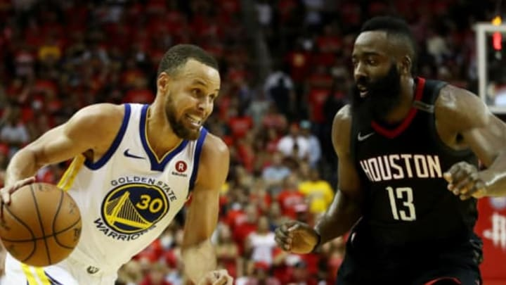 HOUSTON, TX – MAY 28: Stephen Curry #30 of the Golden State Warriors drives against James Harden #13 of the Houston Rockets in the second half of Game Seven of the Western Conference Finals of the 2018 NBA Playoffs at Toyota Center on May 28, 2018 in Houston, Texas. NOTE TO USER: User expressly acknowledges and agrees that, by downloading and or using this photograph, User is consenting to the terms and conditions of the Getty Images License Agreement. (Photo by Ronald Martinez/Getty Images)