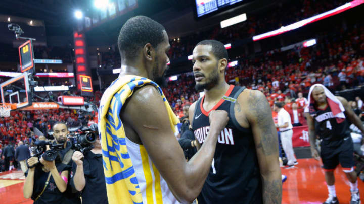HOUSTON, TX - MAY 28: Kevin Durant #35 of the Golden State Warriors talks to Trevor Ariza #1 of the Houston Rockets after Game Seven of the Western Conference Finals during the 2018 NBA Playoffs on May 28, 2018 at the Toyota Center in Houston, Texas. NOTE TO USER: User expressly acknowledges and agrees that, by downloading and/or using this photograph, user is consenting to the terms and conditions of the Getty Images License Agreement. Mandatory Copyright Notice: Copyright 2018 NBAE (Photo by Noah Graham/NBAE via Getty Images)