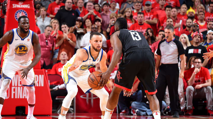 Stephen Curry #30 of the Golden State Warriors defends James Harden #13 of the Houston Rockets Photo by Andrew D. Bernstein/NBAE via Getty Images