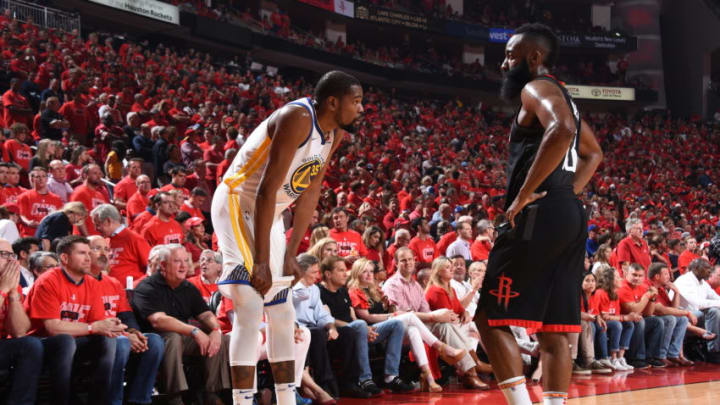 HOUSTON, TX - MAY 28: Kevin Durant #35 of the Golden State Warriors and James Harden #13 of the Houston Rockets during Game Seven of the Western Conference Finals of the 2018 NBA Playoffs on May 28, 2018 at the Toyota Center in Houston, Texas. NOTE TO USER: User expressly acknowledges and agrees that, by downloading and or using this photograph, User is consenting to the terms and conditions of the Getty Images License Agreement. Mandatory Copyright Notice: Copyright 2018 NBAE (Photo by Andrew D. Bernstein/NBAE via Getty Images)