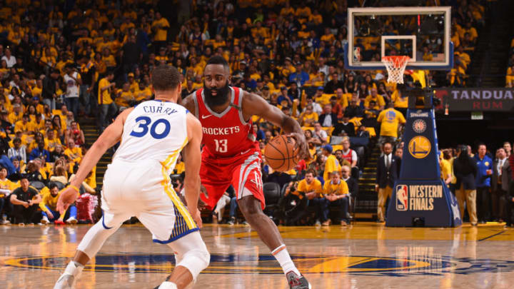 OAKLAND, CA - MAY 26: Stephen Curry #30 of the Golden State Warriors defends against James Harden #13 of the Houston Rockets during Game Six of the Western Conference Finals during the 2018 NBA Playoffs on May 26, 2018 at ORACLE Arena in Oakland, California. NOTE TO USER: User expressly acknowledges and agrees that, by downloading and/or using this Photograph, user is consenting to the terms and conditions of the Getty Images License Agreement. Mandatory Copyright Notice: Copyright 2018 NBAE (Photo by Noah Graham/NBAE via Getty Images)
