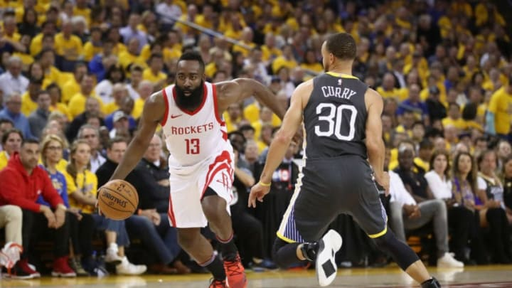 James Harden #13 of the Houston Rockets is guarded by Stephen Curry #30 of the Golden State Warriors (Photo by Ezra Shaw/Getty Images)