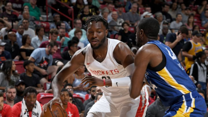 LAS VEAGS, NV - JULY 8: Chinanu Onuaku #21 of the Houston Rockets handles the ball against the Golden States Warriors during the 2018 Las Vegas Summer League on July 8, 2018 at the Thomas & Mack Center in Las Vegas, Nevada. NOTE TO USER: User expressly acknowledges and agrees that, by downloading and/or using this Photograph, user is consenting to the terms and conditions of the Getty Images License Agreement. Mandatory Copyright Notice: Copyright 2018 NBAE (Photo by Garrett Ellwood/NBAE via Getty Images)