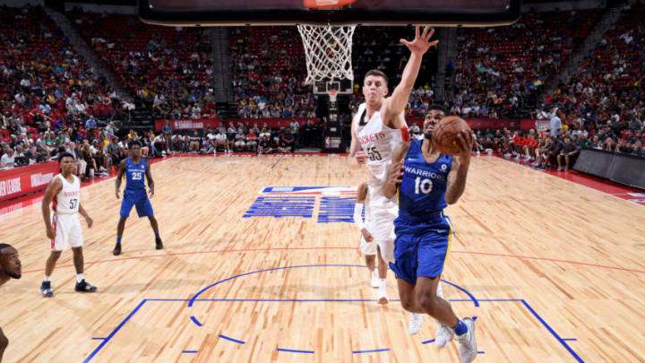 LAS VEAGS, NV - JULY 8: Jacob Evans #10 of Golden State Warriors goes to the basket against the Houston Rockets during the 2018 Las Vegas Summer League on July 8, 2018 at the Thomas & Mack Center in Las Vegas, Nevada. NOTE TO USER: User expressly acknowledges and agrees that, by downloading and/or using this Photograph, user is consenting to the terms and conditions of the Getty Images License Agreement. Mandatory Copyright Notice: Copyright 2018 NBAE (Photo by Garrett Ellwood/NBAE via Getty Images)