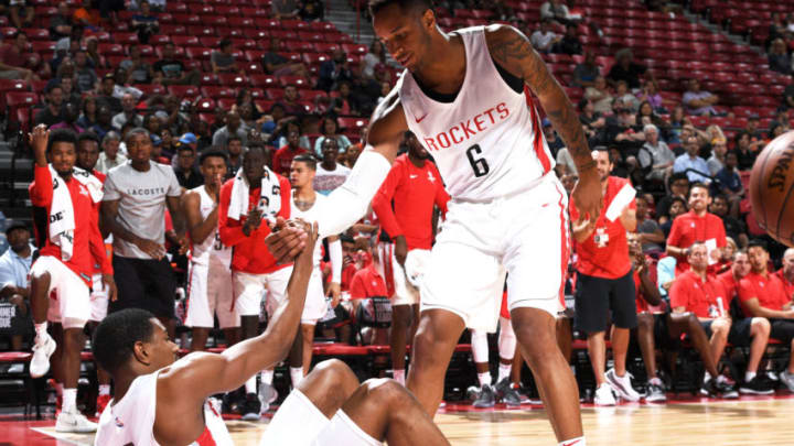 LAS VEGAS, NV - JULY 9: Vincent Edwards #6 of the Houston Rockets helps De'Anthony Melton #0 of the Houston Rockets from the floor during the 2018 Las Vegas Summer League on July 9, 2018 at the Thomas & Mack Center in Las Vegas, Nevada. NOTE TO USER: User expressly acknowledges and agrees that, by downloading and or using this Photograph, user is consenting to the terms and conditions of the Getty Images License Agreement. Mandatory Copyright Notice: Copyright 2018 NBAE (Photo by Garrett Ellwood/NBAE via Getty Images)