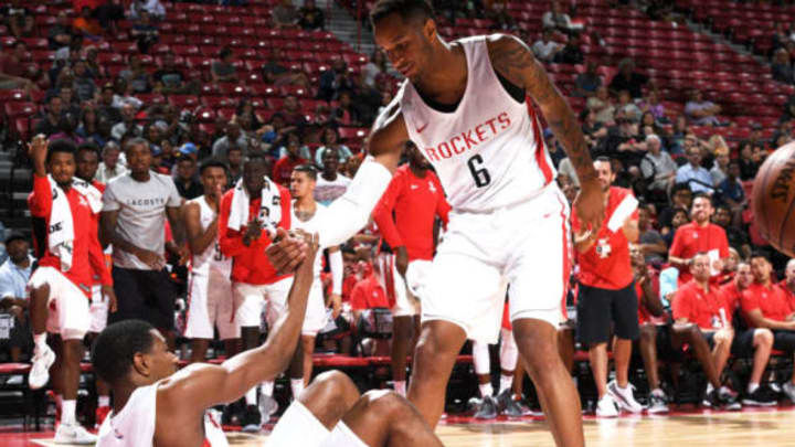 LAS VEGAS, NV – JULY 9: Vincent Edwards #6 of the Houston Rockets helps De'Anthony Melton #0 of the Houston Rockets from the floor during the 2018 Las Vegas Summer League on July 9, 2018 at the Thomas & Mack Center in Las Vegas, Nevada. NOTE TO USER: User expressly acknowledges and agrees that, by downloading and or using this Photograph, user is consenting to the terms and conditions of the Getty Images License Agreement. Mandatory Copyright Notice: Copyright 2018 NBAE (Photo by Garrett Ellwood/NBAE via Getty Images)