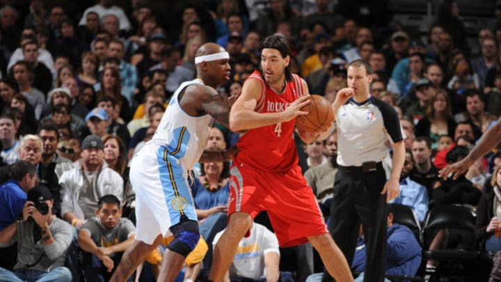 DENVER, CO - APRIL 15: Luis Scola #4 of the Houston Rockets looks to post up against Al Harrington #7 of the Denver Nuggets on April 15, 2012 at the Pepsi Center in Denver, Colorado. (Photo by Garrett W. Ellwood/NBAE via Getty Images)