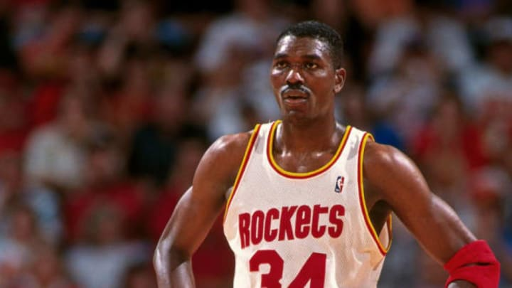 HOUSTON, TX – JUNE 10: Hakeem Olajuwon #34 of the Houston Rockets stands on the court during Game Two of the NBA Finals. NOTE TO USER: User expressly acknowledges that, by downloading and or using this photograph. User is consenting to the terms and conditions of the Getty Images License agreement. Mandatory Copyright Notice: Copyright 1994 NBAE (Photo by Bill Baptist/NBAE via Getty Images)