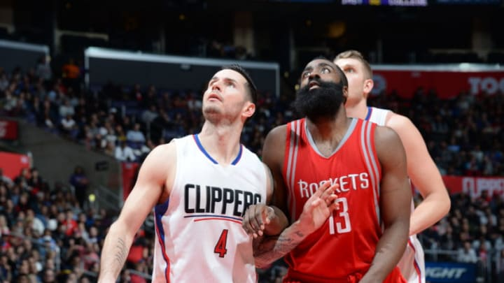 LOS ANGELES, CA - JANUARY 18: J.J. Redick #4 of the Los Angeles Clippers looks for the rebound against James Harden #13 of the Houston Rockets during the game on January 18, 2016 at STAPLES Center in Los Angeles, California. NOTE TO USER: User expressly acknowledges and agrees that, by downloading and or using this Photograph, user is consenting to the terms and conditions of the Getty Images License Agreement. Mandatory Copyright Notice: Copyright 2016 NBAE (Photo by Andrew Bernstein/NBAE via Getty Images)