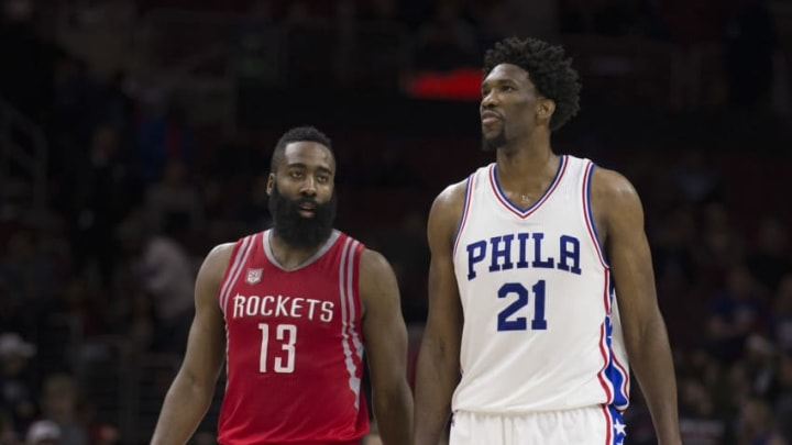 James Harden #13 of the Houston Rockets talks to Joel Embiid #21 of the Philadelphia 76ers (Photo by Mitchell Leff/Getty Images)