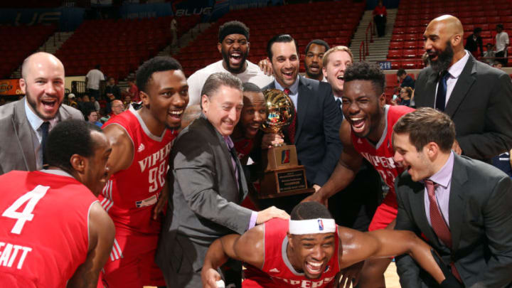OKLAHOMA CITY, OK - APRIL 19: Tommy Smith, vice president of the NBA Development League presents the Western Conference Finals trophy to Rio Grande Valley Vipers head coach Matt Brass after they defeated the Oklahoma City Blue 114-102 in Game 3 of the Western Conference Finals of an NBA D-League playoff game on April 19, 2017 at the Cox Convention Center in Oklahoma City, Oklahoma. NOTE TO USER: User expressly acknowledges and agrees that, by downloading and or using this Photograph, user is consenting to the terms and conditions of the Getty Images License Agreement. Mandatory Copyright Notice: Copyright 2017 NBAE (Photo by Layne Murdoch/NBAE via Getty Images)
