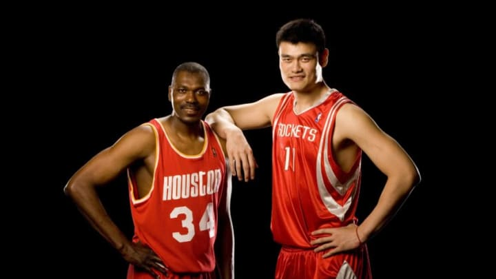 HOUSTON - JUNE 12: Former NBA player Hakeem Olajuwon and Yao Ming #11 of the Houston Rockets pose for photos at the Toyota Center on June 12, 2007 in Houston, Texas. NOTE TO USER: User expressly acknowledges and agrees that, by downloading and/or using this photograph, User is consenting to the terms and conditions of the Getty Images License Agreement. Mandatory Copyright Notice: Copyright 2007 NBAE (Photo by Bill Baptist/NBAE via Getty Images)