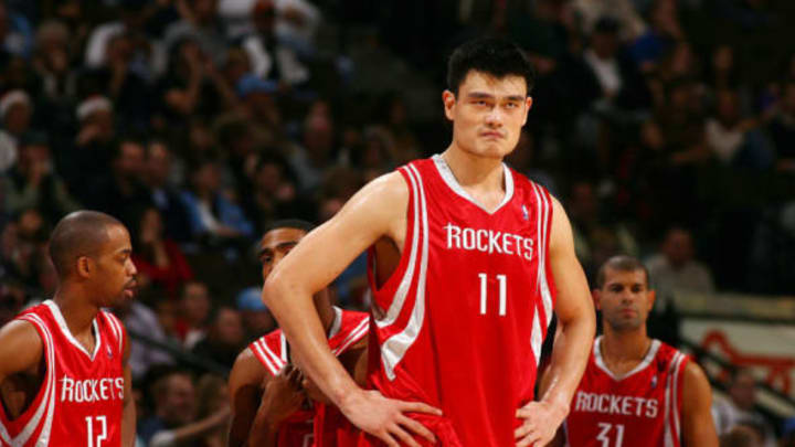 DENVER – DECEMBER 20: An intense Yao Ming #11 of the Houston Rockets gets ready for double overtime against the Denver Nuggets on December 20, 2007 at the Pepsi Center in Denver, Colorado. NOTE TO USER: User expressly acknowledges and agrees that, by downloading and/or using this Photograph, user is consenting to the terms and conditions of the Getty Images License Agreement. Mandatory Copyright Notice: Copyright 2007 NBAE