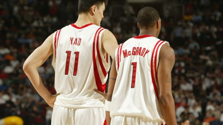 HOUSTON - FEBRUARY 21: Yao Ming #11 and Tracy McGrady #1 of the Houston Rockets stand on the court during the game against the Miami Heat on February 21, 2008 at the Toyota Center in Houston, Texas. The Rockets won 112-100. NOTE TO USER: User expressly acknowledges and agrees that, by downloading and or using this Photograph, user is consenting to the terms and conditions of the Getty Images License Agreement. Mandatory Copyright Notice: Copyright 2008 NBAE (Photo by Bill Baptist/NBAE via Getty Images)
