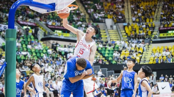 HONG KONG, HONG KONG - JULY 30: Zhou Qi of Chinese Men's Basketball Stars Team goes up for a dunk against American Professional Nike Rising Star Team during Yao Foundation Charity Tour match between American Professional Nike Rising Star Team and Chinese Men's Basketball Stars Team on July 30, 2017 in Hong Kong, Hong Kong. (Photo by Power Sport Images/Getty Images)