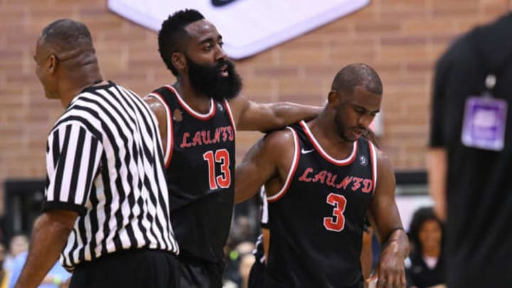 LOS ANGELES, CA – JULY 30: Houston Rockets guards James Harden (13) and Chris Paul (3) share a moment during a Drew League game at King Drew Magnet High School on July 30th, 2017. (Photo by Brian Rothmuller/Icon Sportswire via Getty Images)
