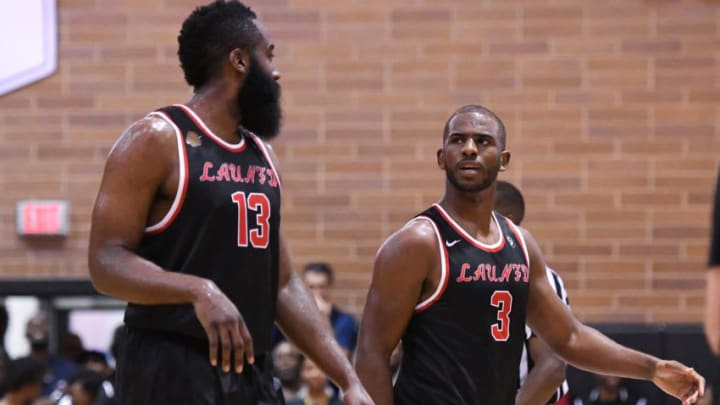 LOS ANGELES, CA - JULY 30: Houston Rockets guards Chris Paul (3) talks with James Harden (13) during a Drew League game at King Drew Magnet High School on July 30th, 2017. (Photo by Brian Rothmuller/Icon Sportswire via Getty Images)