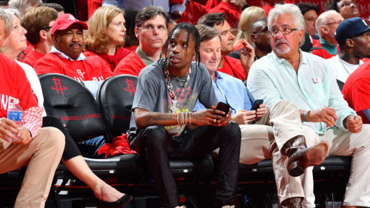 HOUSTON, TX - MAY 11: Rapper, Travis Scott is seen at the game between the Houston Rockets and the San Antonio Spurs during Game Six of the Western Conference Semifinals of the 2017 NBA Playoffs on May 11, 2017 at the Toyota Center in Houston, Texas. NOTE TO USER: User expressly acknowledges and agrees that, by downloading and or using this photograph, User is consenting to the terms and conditions of the Getty Images License Agreement. Mandatory Copyright Notice: Copyright 2017 NBAE (Photo by Jesse D. Garrabrant/NBAE via Getty Images)
