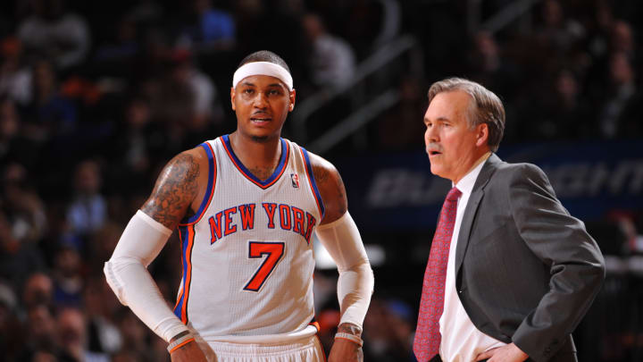 Carmelo Anthony #7 of the New York Knicks talks to head coach Mike D'Antoni during the game against the Philadelphia 76ers Photo by Jesse D. Garrabrant/NBAE via Getty Images