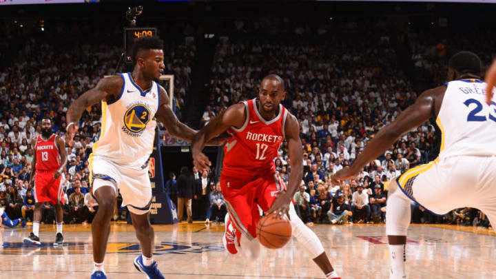 OAKLAND, CA - OCTOBER 17: Luc Mbah a Moute #12 of the Houston Rockets handles the ball against the Golden State Warriors on October 17, 2017 at ORACLE Arena in Oakland, California. NOTE TO USER: User expressly acknowledges and agrees that, by downloading and or using this photograph, user is consenting to the terms and conditions of Getty Images License Agreement. Mandatory Copyright Notice: Copyright 2017 NBAE (Photo by Noah Graham/NBAE via Getty Images)