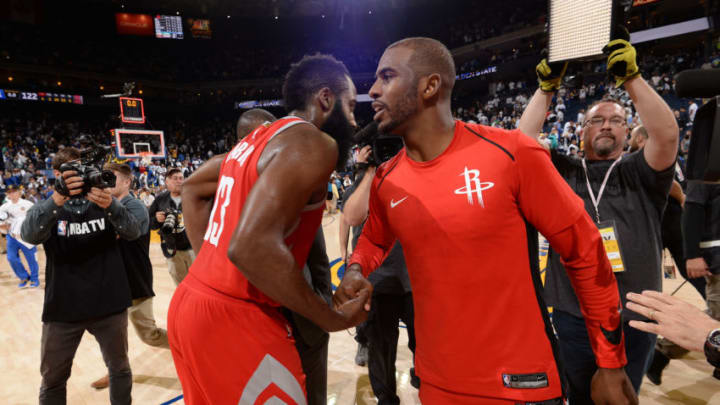 OAKLAND, CA - OCTOBER 17: James Harden #13 and Chris Paul #3 of the Houston Rockets high five after the game against the Golden State Warriors on October 17, 2017 at ORACLE Arena in Oakland, California. NOTE TO USER: User expressly acknowledges and agrees that, by downloading and or using this photograph, user is consenting to the terms and conditions of Getty Images License Agreement. Mandatory Copyright Notice: Copyright 2017 NBAE (Photo by Andrew D. Bernstein/NBAE via Getty Images)