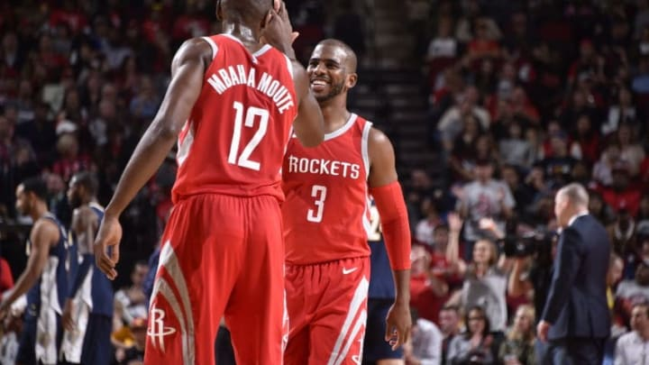 HOUSTON, TX - NOVEMBER 22: Chris Paul #3 and Luc Mbah a Moute #12 of the Houston Rockets celebrate a win against the Denver Nuggets on November 22, 2017 at the Toyota Center in Houston, Texas. NOTE TO USER: User expressly acknowledges and agrees that, by downloading and or using this photograph, User is consenting to the terms and conditions of the Getty Images License Agreement. Mandatory Copyright Notice: Copyright 2017 NBAE (Photo by Bill Baptist/NBAE via Getty Images)