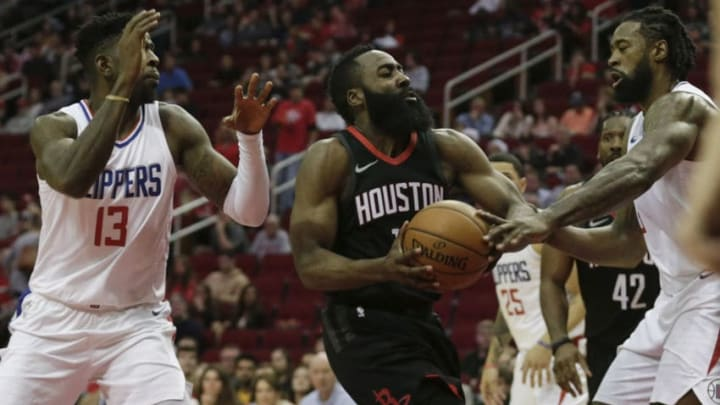 HOUSTON, TX - DECEMBER 22: James Harden #13 of the Houston Rockets drives to the basket defended by DeAndre Jordan #6 of the LA Clippers and Jamil Wilson #13 in the first half at Toyota Center on December 22, 2017 in Houston, Texas. NOTE TO USER: User expressly acknowledges and agrees that, by downloading and or using this Photograph, user is consenting to the terms and conditions of the Getty Images License Agreement. (Photo by Tim Warner/Getty Images)