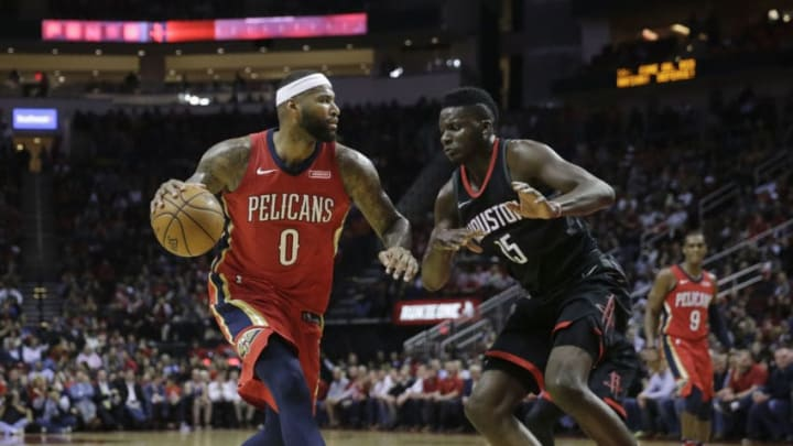 HOUSTON, TX - DECEMBER 11: DeMarcus Cousins #0 of the New Orleans Pelicans drives to the basket defended by Clint Capela #15 of the Houston Rockets in the first half at Toyota Center on December 11, 2017 in Houston, Texas. NOTE TO USER: User expressly acknowledges and agrees that, by downloading and or using this photograph, User is consenting to the terms and conditions of the Getty Images License Agreement. (Photo by Tim Warner/Getty Images)