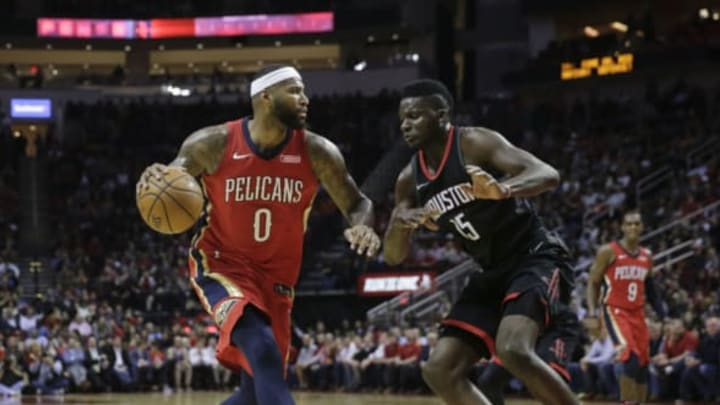 HOUSTON, TX – DECEMBER 11: DeMarcus Cousins #0 of the New Orleans Pelicans drives to the basket defended by Clint Capela #15 of the Houston Rockets in the first half at Toyota Center on December 11, 2017 in Houston, Texas. NOTE TO USER: User expressly acknowledges and agrees that, by downloading and or using this photograph, User is consenting to the terms and conditions of the Getty Images License Agreement. (Photo by Tim Warner/Getty Images)