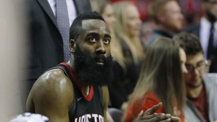 HOUSTON, TX - DECEMBER 31: James Harden #13 of the Houston Rockets claps on the bench in the second half against the Los Angeles Lakers at Toyota Center on December 31, 2017 in Houston, Texas. NOTE TO USER: User expressly acknowledges and agrees that, by downloading and or using this photograph, User is consenting to the terms and conditions of the Getty Images License Agreement. (Photo by Tim Warner/Getty Images)