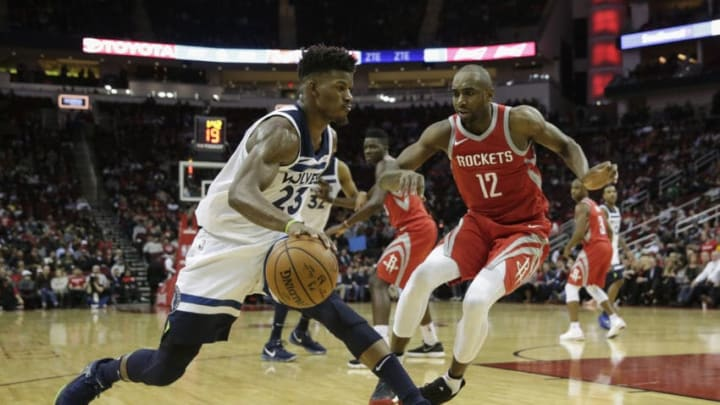 HOUSTON, TX - JANUARY 18: Jimmy Butler #23 of the Minnesota Timberwolves drives to the basket defended by Luc Mbah a Moute #12 of the Houston Rockets in the second half at Toyota Center on January 18, 2018 in Houston, Texas. NOTE TO USER: User expressly acknowledges and agrees that, by downloading and or using this Photograph, user is consenting to the terms and conditions of the Getty Images License Agreement. (Photo by Tim Warner/Getty Images)
