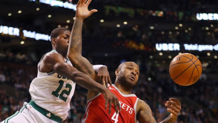 BOSTON, MA - DECEMBER 28: Boston Celtics Terry Rozier, left, knocks the ball away from Houston Rockets P.J. Tucker, right, during the fourth quarter of a game at the TD Garden in Boston, Dec. 28, 2017. (Photo by John Tlumacki/The Boston Globe via Getty Images)