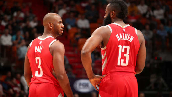 MIAMI, FL - DECEMBER 1: James Harden #13 of the Houston Rockets and Chris Paul #3 of the Houston Rockets talk during the game against the Miami Heat on February 7, 2018 at American Airlines Arena in Miami, Florida. NOTE TO USER: User expressly acknowledges and agrees that, by downloading and or using this Photograph, user is consenting to the terms and conditions of the Getty Images License Agreement. Mandatory Copyright Notice: Copyright 2018 NBAE (Photo by Issac Baldizon/NBAE via Getty Images)