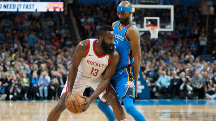 OKLAHOMA CITY, OK - MARCH 06: Houston Rockets Guard James Harden (13) looking to make a play while Oklahoma City Thunder Forward Corey Brewer (3) plays defense on March 06, 2018 at Chesapeake Energy Arena in Oklahoma City, OK.(Photo by Torrey Purvey/Icon Sportswire via Getty Images)