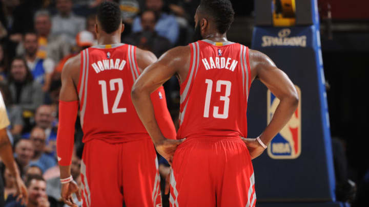 OAKLAND, CA - FEBRUARY 9: Dwight Howard #12 and James Harden #13 of the Houston Rockets while facing the Golden State Warriors on February 9, 2016 at Oracle Arena in Oakland, California. NOTE TO USER: User expressly acknowledges and agrees that, by downloading and or using this photograph, user is consenting to the terms and conditions of Getty Images License Agreement. Mandatory Copyright Notice: Copyright 2016 NBAE (Photo by Noah Graham/NBAE via Getty Images)
