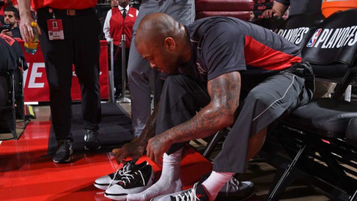 HOUSTON, TX - APRIL 15: PJ Tucker #4 of the Houston Rockets switches his sneakers before Game One of Round One of the 2018 NBA Playoffs against the Minnesota Timberwolves on April 15, 2018 at the Toyota Center in Houston, Texas. NOTE TO USER: User expressly acknowledges and agrees that, by downloading and or using this photograph, User is consenting to the terms and conditions of the Getty Images License Agreement. Mandatory Copyright Notice: Copyright 2018 NBAE (Photo by Bill Baptist/NBAE via Getty Images)