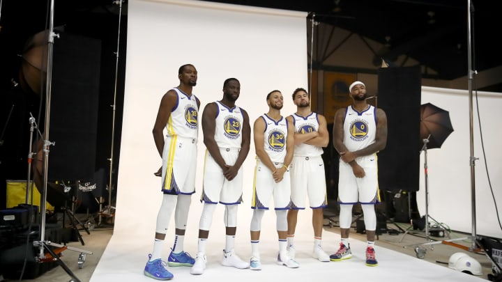 OAKLAND, CA – SEPTEMBER 24: (L-R) Kevin Durant #35, Draymond Green #23, Stephen Curry #30, Klay Thompson #11, and DeMarcus Cousins #0 of the Golden State Warriors pose for a group picture during the Golden State Warriors media day on September 24, 2018 in Oakland, California. (Photo by Ezra Shaw/Getty Images)