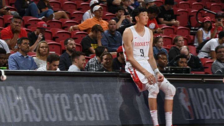 LAS VEGAS, NV - JULY 9: Zhou Qi #9 of the Houston Rockets looks on against the LA Clippers during the 2018 Las Vegas Summer League on July 9, 2018 at the Thomas & Mack Center in Las Vegas, Nevada. NOTE TO USER: User expressly acknowledges and agrees that, by downloading and or using this Photograph, user is consenting to the terms and conditions of the Getty Images License Agreement. Mandatory Copyright Notice: Copyright 2018 NBAE (Photo by Garrett Ellwood/NBAE via Getty Images)