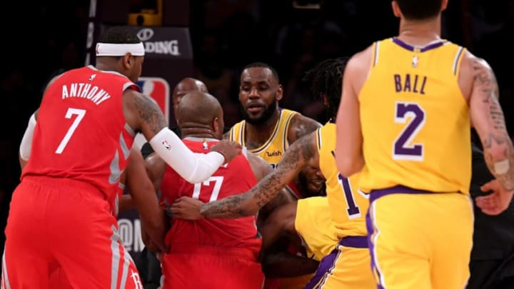 LOS ANGELES, CA - OCTOBER 20: Chris Paul #3 of the Houston Rockets and Rajon Rondo #9 of the Los Angeles Lakers fight during a 124-115 Rockets win at Staples Center on October 20, 2018 in Los Angeles, California. (Photo by Harry How/Getty Images)