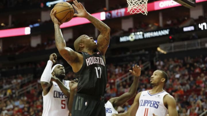 HOUSTON, TX - OCTOBER 26: PJ Tucker #17 of the Houston Rockets goes up for a shot defended by Avery Bradley #11 of the Los Angeles Clippers and Montrezl Harrell #5 in the first half at Toyota Center on October 26, 2018 in Houston, Texas. NOTE TO USER: User expressly acknowledges and agrees that, by downloading and or using this Photograph, user is consenting to the terms and conditions of the Getty Images License Agreement. (Photo by Tim Warner/Getty Images)